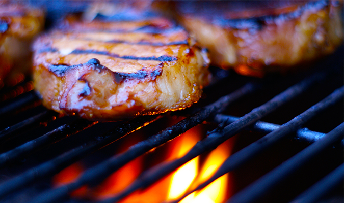 football tailgate grilling pork chops