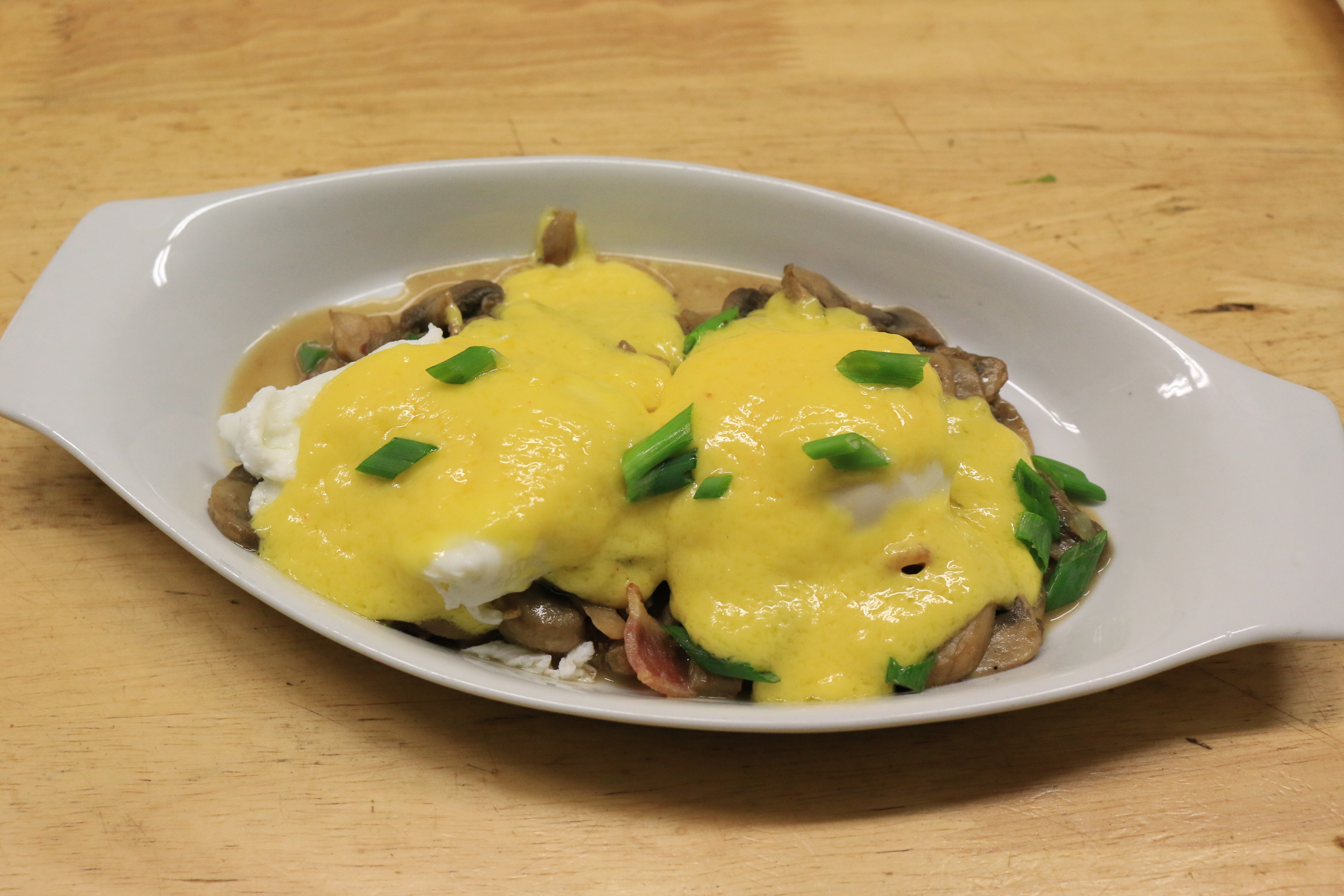 Eggs Benedict Over Mushrooms and Bacon