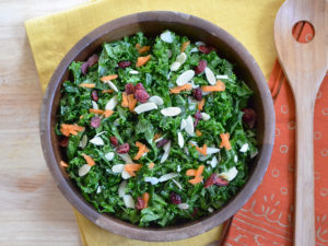 kale salad in wooden blowl