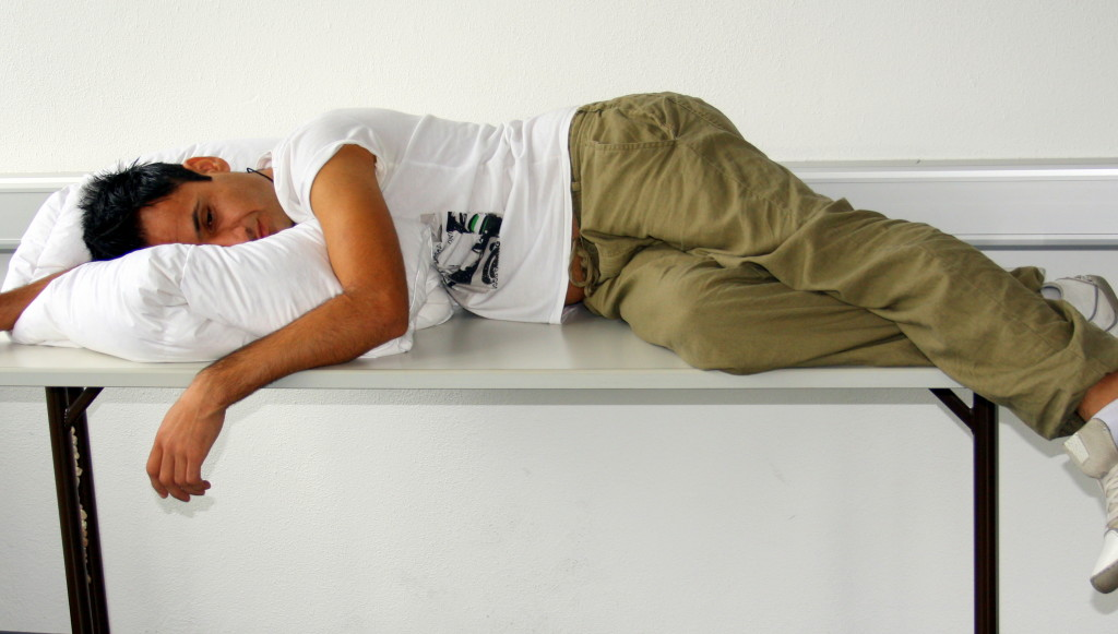 student sleeping on table