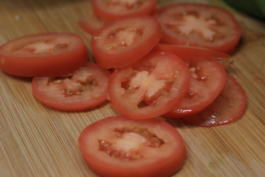 Sliced tomatoes go great on our paleo BLT wrap.