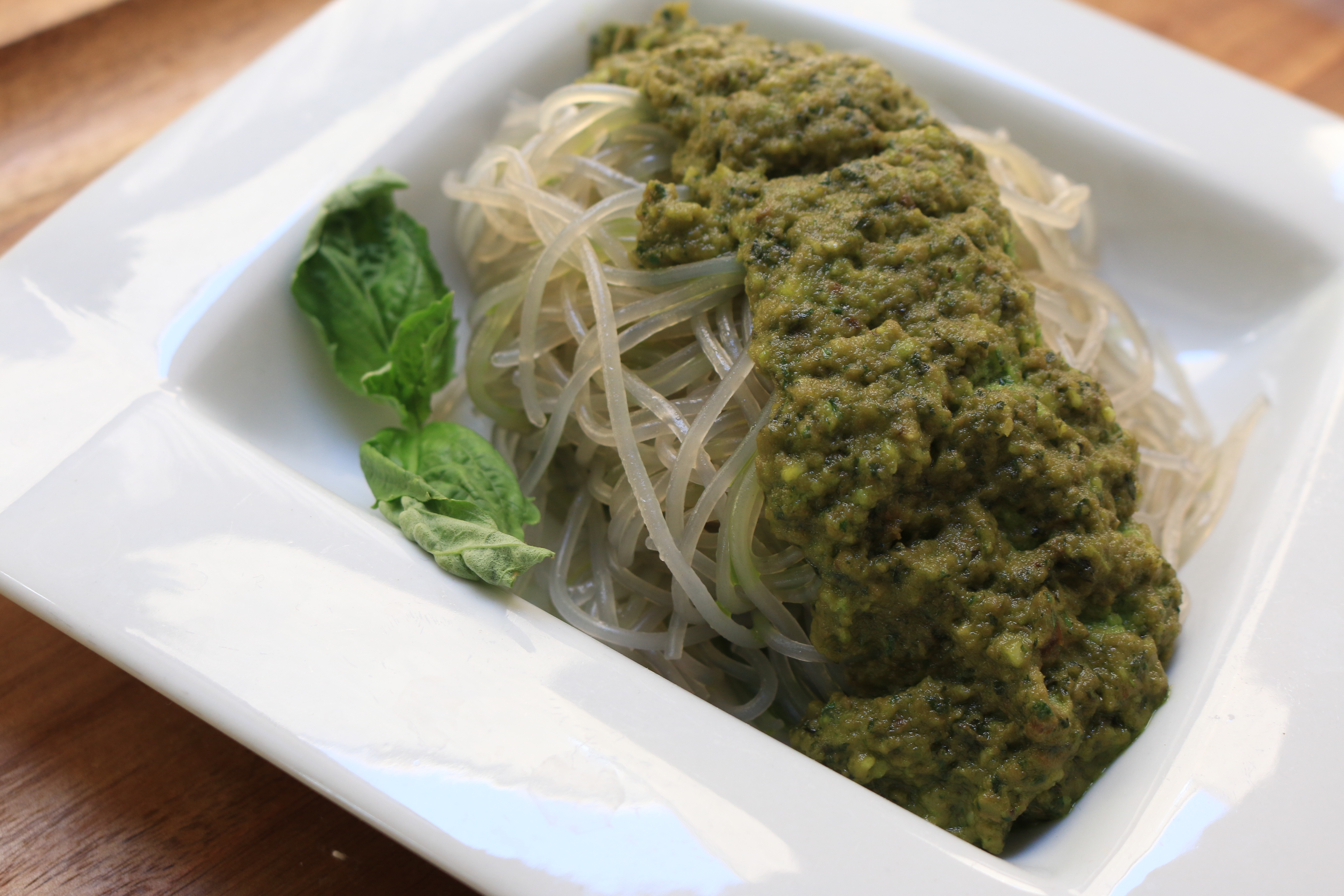 Fresh avocado is combined with fresh basil pesto to make the perfect italian flavor combo. Add it to a bed of sweet potato noodles for a quick and easy dinner.